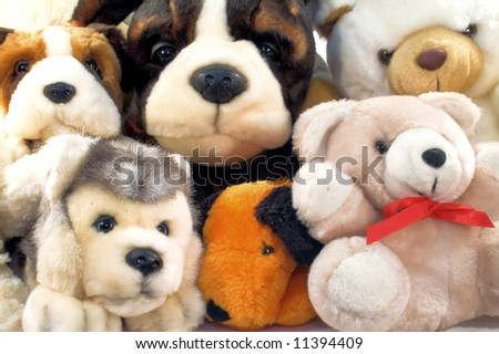 Pile of plush animals with dogs and teddies