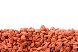 Pile of potassium chloride. Isolate. Close-up. Copy space. Potassium chloride is a red mineral fertilizer close-up. The texture of granular potassium chloride is red.