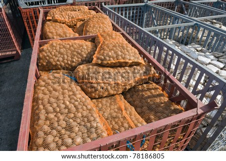 Pile of potato bags in the containers