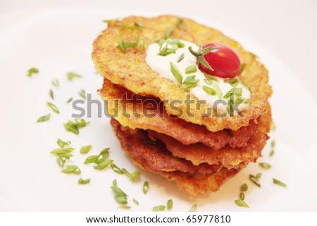 Pile of potato pancakes with the sour cream