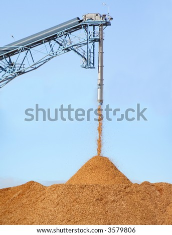 Pile of pouring wood chips