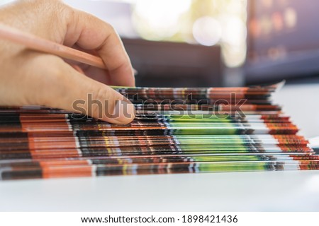 Pile of presentation brochure document concept : Businessman hands working in business Documents on Stacks Brochures papers files for checking achieves reports on busy work computer desk office Stock photo ©