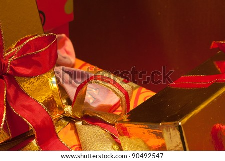 Pile of presents wrapped in gold paper