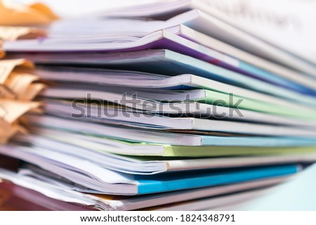 Pile of publication books or documents report papers waiting be managed on desk in busy office. Concept of workload in business finacial paperwork Сток-фото ©