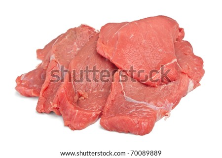 Pile of raw red meat on white background