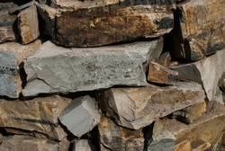 Pile of raw sandstone pieces from a quary. Natural building material.