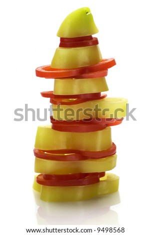 Pile of red and green pepper isolated on white