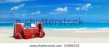 Pile of  red baggage on a tropical beach