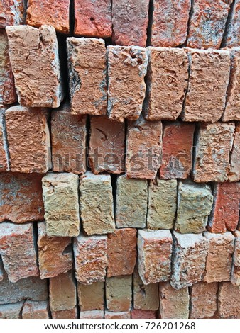 Pile of red bricks at construction site. Brick texture background