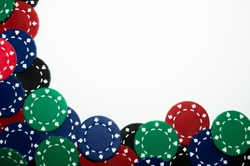 Pile of red, green, black, and blue poker chips isolated on white background
