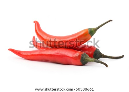 Pile of red hot chili peppers isolated on white background.