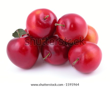 pile of red plums isolated on white