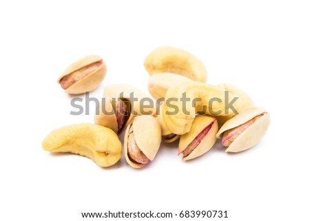 Pile of roasted pistachios and cashew isolated on white background #683990731