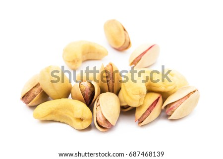 Pile of roasted pistachios and cashew  isolated on white background  #687468139