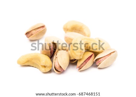 Pile of roasted pistachios and cashew  isolated on white background  #687468151