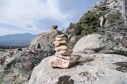 Pile of rocks indicate the correct path on a route near Pico de la Miel in La Cabrera, Madrid.