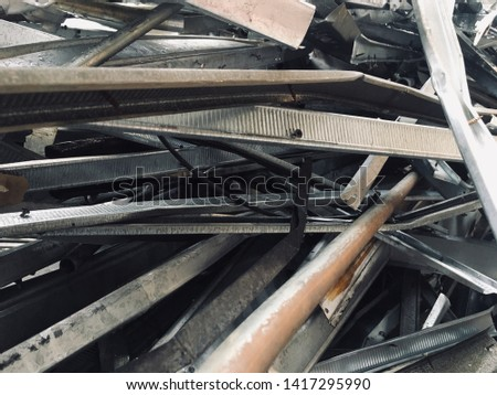 Pile of rubble from demolished building containing twisted steel