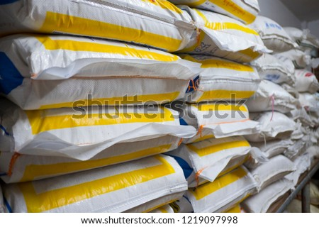 Pile of sack in warehouse. Background and texture of sack stack in warehouse. #1219097998