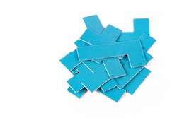 Pile of scattered blue geometrical pieces, simple shapes stack, heap Bunch of unlinked not connected elements isolated on white cut out Parts for building, constructing, putting together, mess concept