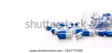Pile of scattered capsules on a white background. capsules isolated white capsule pharmacy bottle pill drug concept