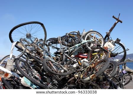 Pile of scrap metal against blue sky