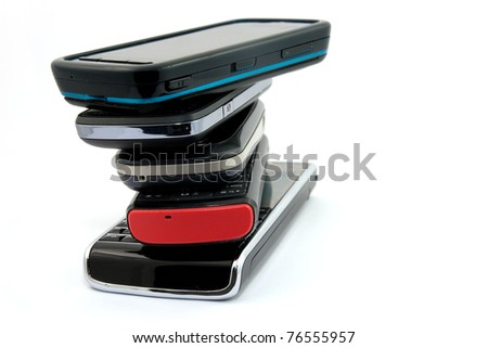 Pile of Several Modern Mobile Phones  Isolated on White Background