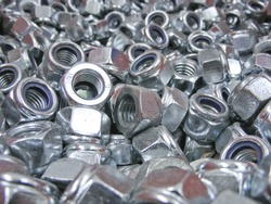 Pile of shiny new metal lock nuts.