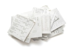 Pile of shopping receipts on white background