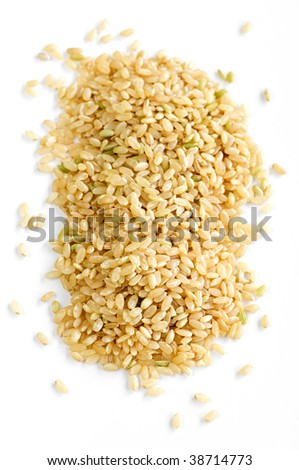 Pile of short brown rice grains isolated on white background