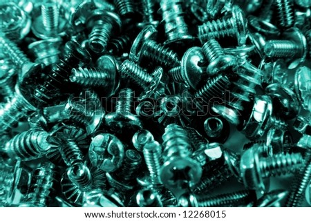 Pile of small screws in blue