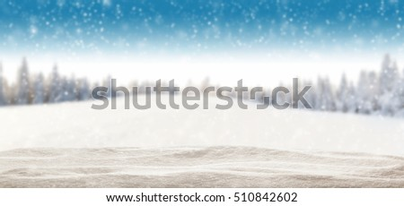 Pile of snow with blur winter panorama. Landscape with spruce trees, blue sky with sun light on background #510842602
