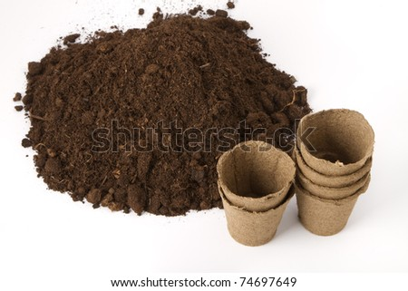 pile of soil and peat pots for seedlings