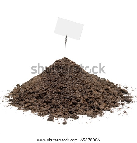 Pile of soil with a display for messages against white background