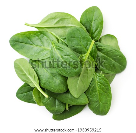 Pile of spinach leaves close-up on a white background. Top view. Сток-фото ©