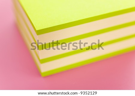 Pile of sticky notes over a pink table