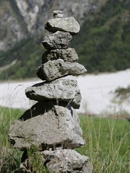pile of stones to symbolize a prayer in the mountains