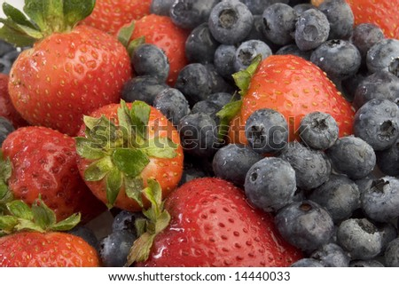 Pile of strawberries and blueberries