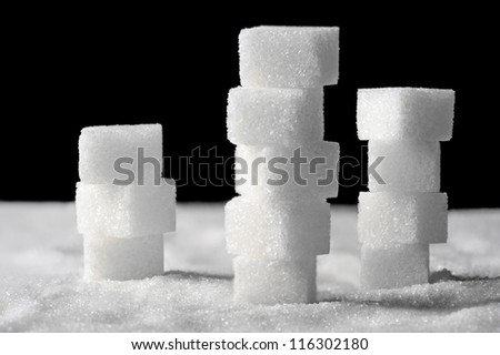 Pile of sugar cubes on black and white background #116302180