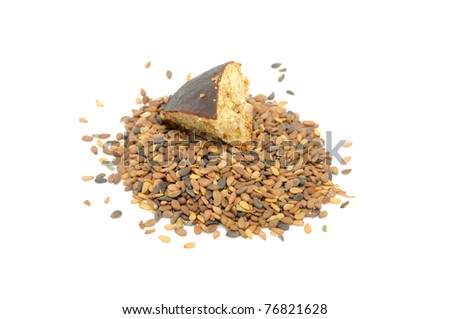 Pile of Tan Sesame Seeds with Piece of Cookie Isolated on White Background