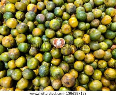 Pile of tangerine. Tangerine is a group of orange-colored citrus fruit consisting of hybrids of mandarin orange. #1386389159