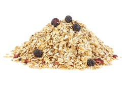 Pile of tasty oatmeal with blueberries on white background. Healthy breakfast.