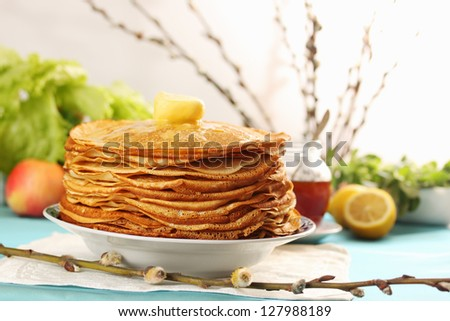 pile of thin pancakes on a plate