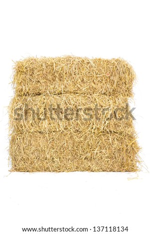 Pile of three layers straw hay isolate on white background
