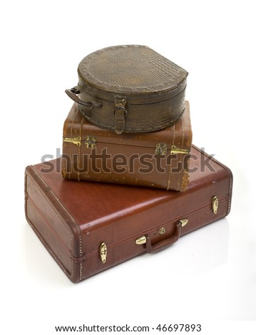 pile of three retro old vintage suitcase isolated on white