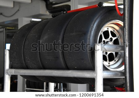 pile of tires of a sports car #1200691354