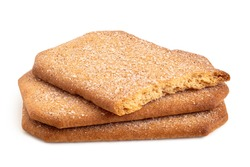 Pile of two and half rectangular sugar coated cinnamon biscuits isolated on white.