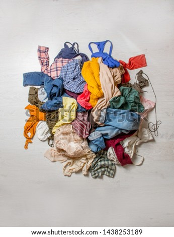 pile of used clothes on a light background. Second hand for recycling #1438253189