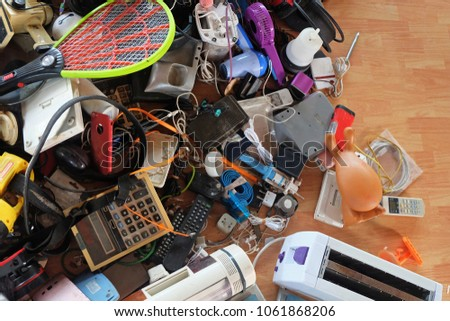 Pile of used Electronic and Housewares Waste Division broken or damage, for Reuse and Recycle