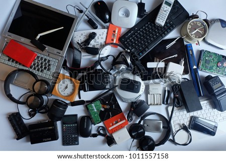 Pile of used Electronic Waste on white background, Reuse and Recycle concept, Top view  #1011557158