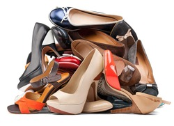 Pile of various female shoes isolated over white, with clipping path